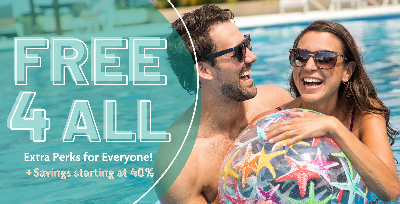 Couple having fun in pool with beach ball