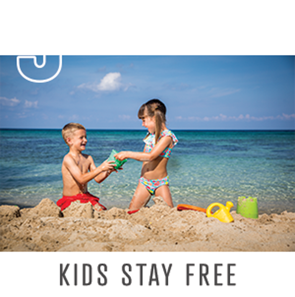 boy and girl playing in sand enjoying free stay